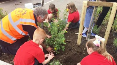Children from Westgate Academy helped to plant trees at The Lawn