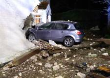 Car crashes into house in Lincoln village