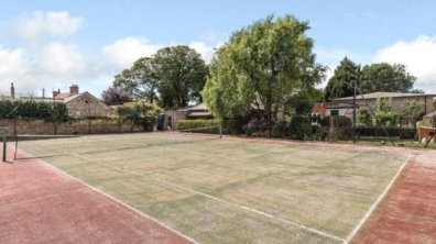 Tennis court at the Dunston home. Photo: Savills