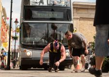 Lincoln strongman pulls double decker filled with people
