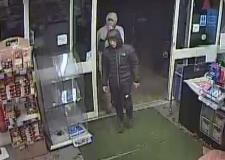 CCTV: Young men flee after raiding village Co-op