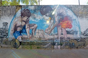 Two boys playing street art in Buenos Aires, Argentina.