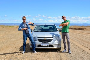 Scott Swiontek and John Line on Ruta 40 with their car, Patagonia, Argentina.
