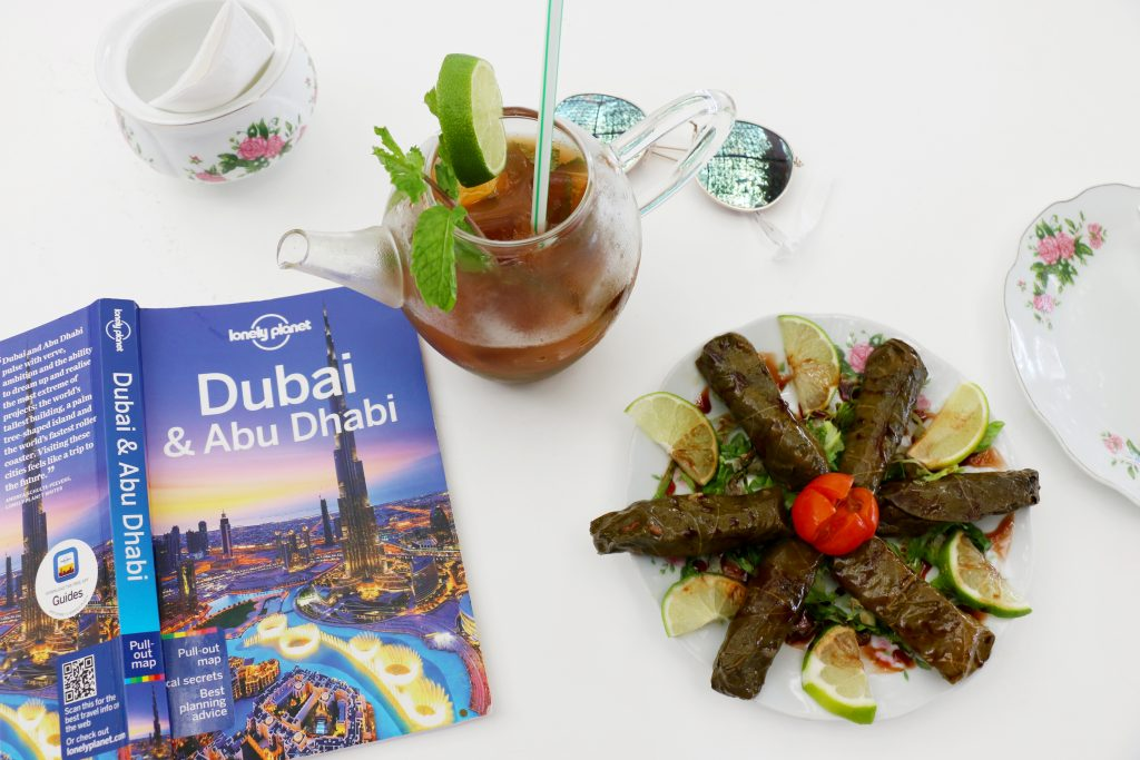 flat lay of tea and food at Arabian Tea House - 2 day itinerary for dubai