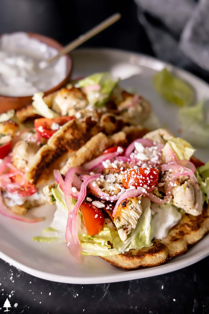 closer view of gyro sandwich on a plate
