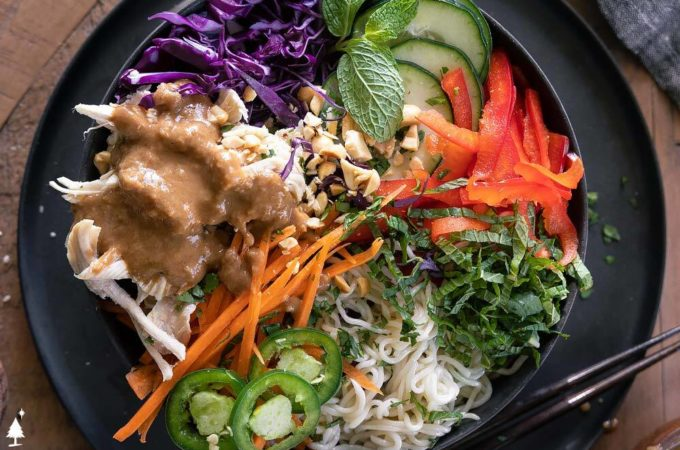 *NEW* Spring roll in a bowl combines all the best colors and flavors, then is tossed in a perfected peanut sauce. #ketospringrollinabowl #lowcarbspringrollinabowl