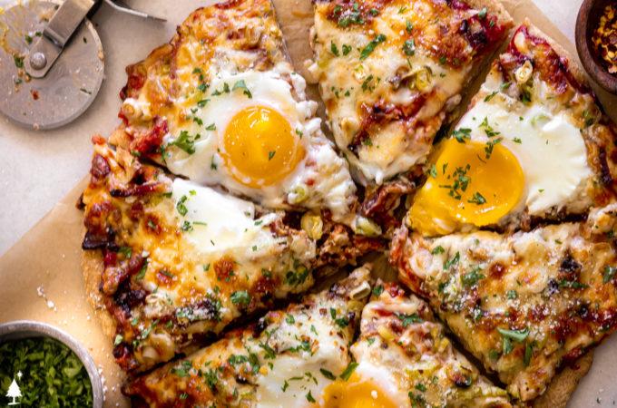 Slices of keto breakfast pizza on a baking sheet