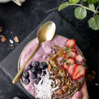 Keto Berry smoothie bowl served with berries and other toppings