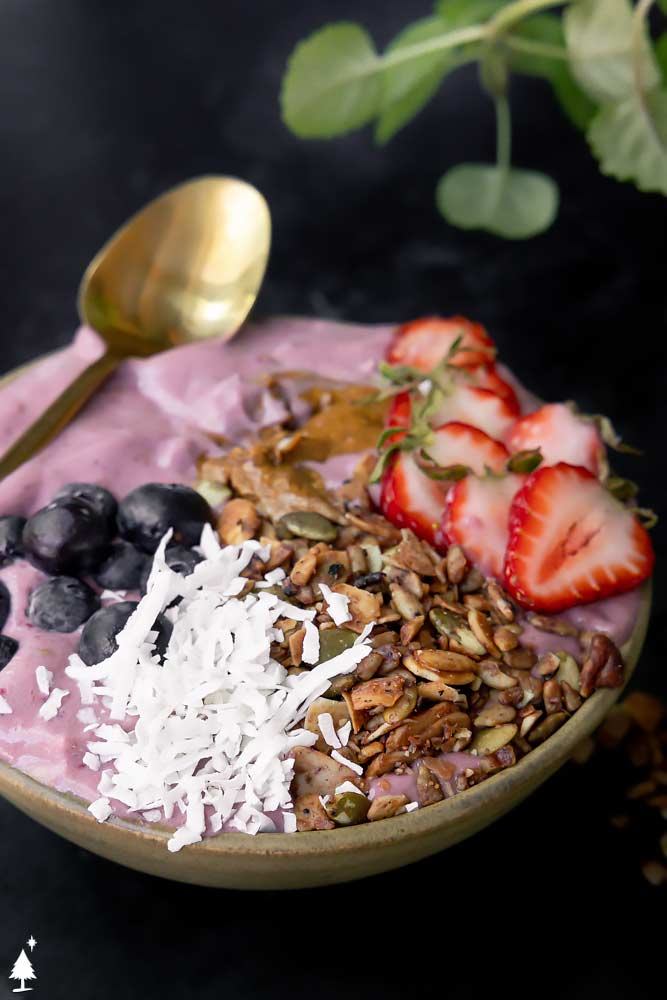 detox smoothie served with berry toppings