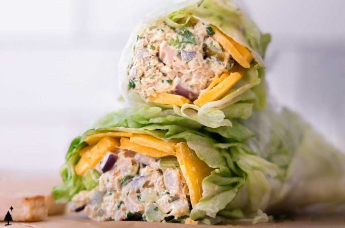 two pieces of best tuna salad in a lettuce wrap