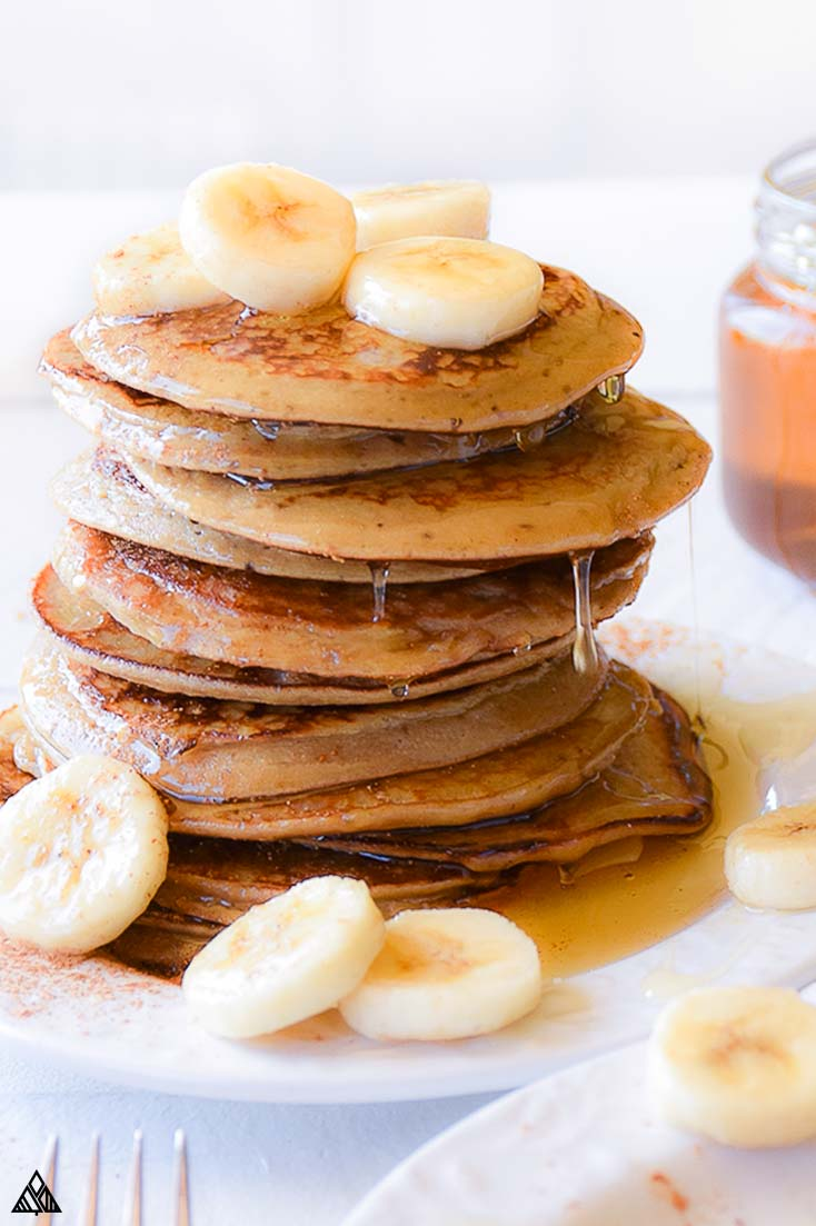 5 minutes + 3 ingredients are all you need for these super fluffy and delicious banana paleo pancakes! No almond flour or coconut flour required!