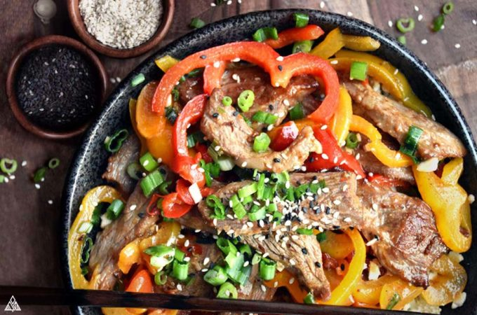 bowl of hunan beef with vegetables