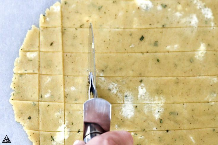 Cutting the dough to form small squares