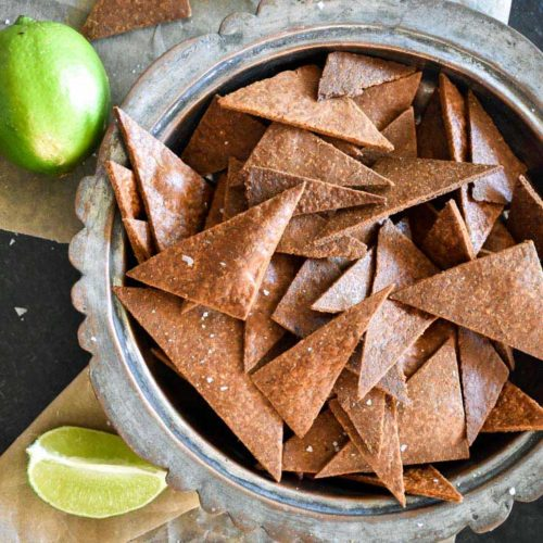 bowl of low carb tortilla chips with limes