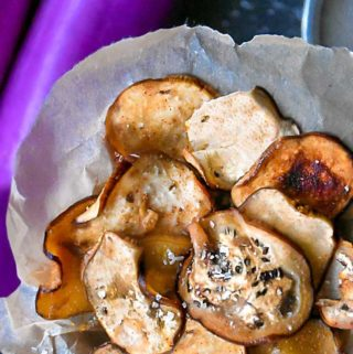 These baked eggplant chips are low carb, crispy, crunchy, salty, smoky, hearty, and every bit as delicious as its boring been-there-done-that potato chip counterpart! #lowcarb #keto #vegan #vegetarian #paleo #glutenfree #healthy #recipe #baked #crispy #dehydrator #oven #roasted #eggplant #veggies #vegetables #lowcarbchips #chips #appetizers #veggiechips
