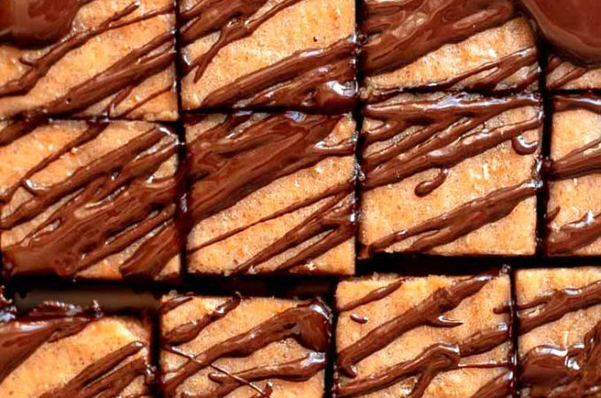 Low carb peanut butter fudge, sliced with chocolate syrup on top