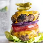 bunless burger with cheese and vegetable toppings, lettuce wrapped