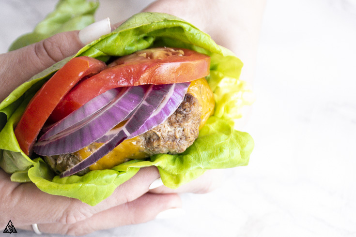 bunless burger with cheese, wrapped in lettuce
