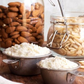 how to make almond flour from almond, almonds in the background and flour in the front