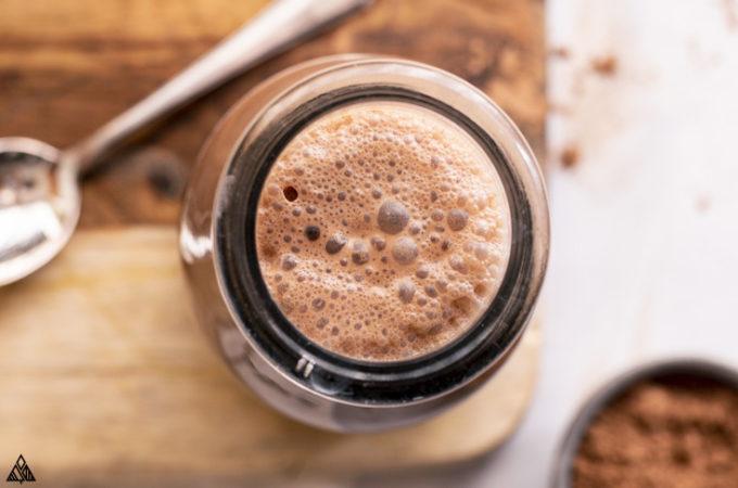 Top view of chocolate milk inside the jar
