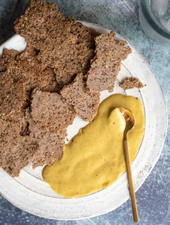 Paleo crackers in a plate with a dip on the side