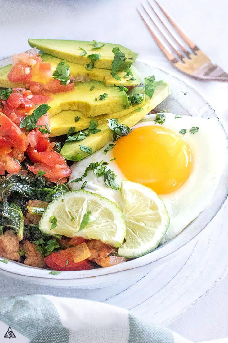 Side view of low carb mexican breakfast bowl in a plate