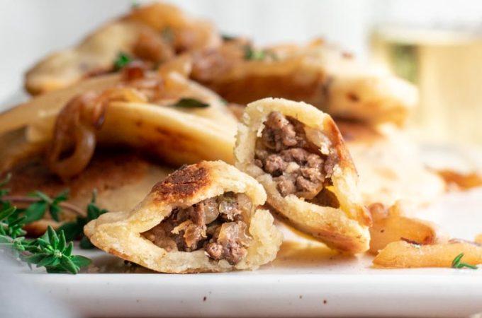 Side view of keto dumplings in a pate
