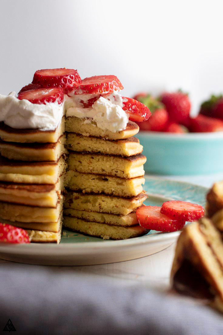 large stack of low carb pancakes with a bite removed