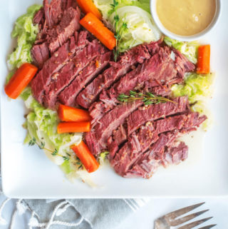 Top view of instant pot corned beef in a white plate