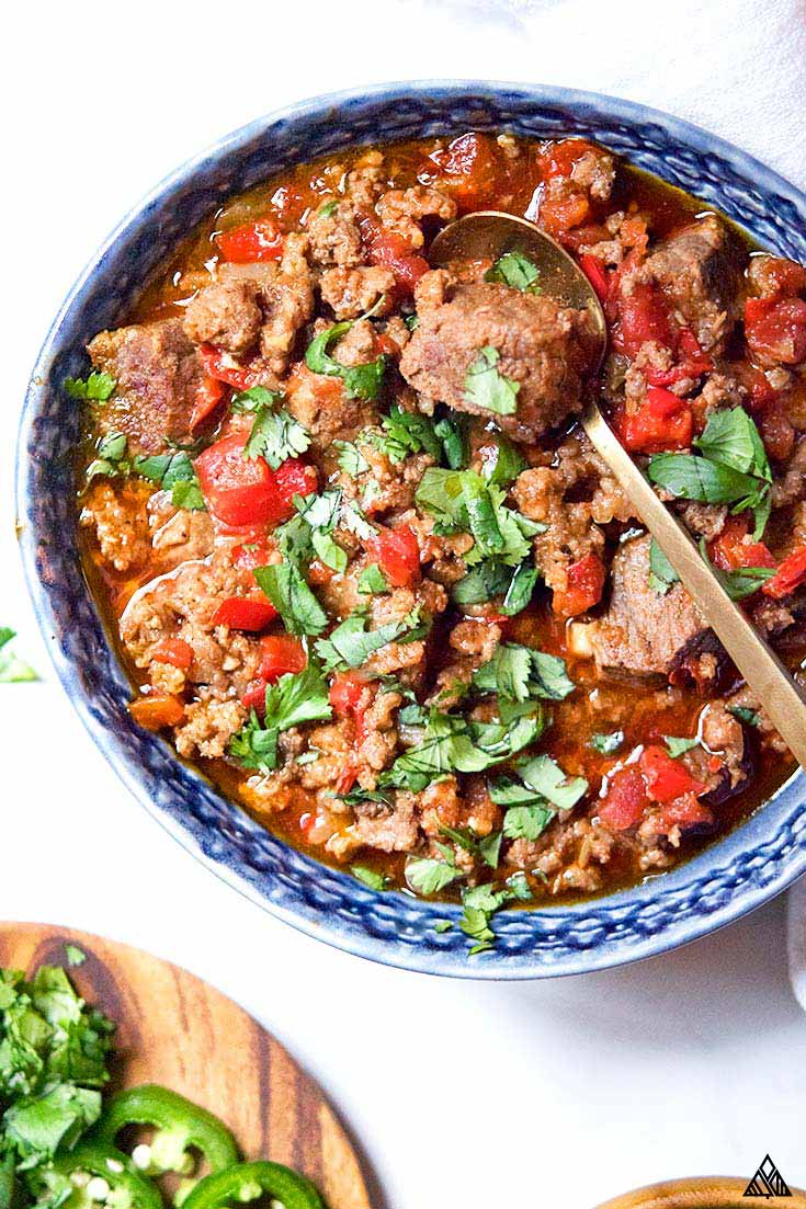 3 meat low carb, keto and paleo chili recipe is so juicy, tender and full of flavor it's all you'll ever want for dinner! Perfect to make on the stove, in the crockpot or instant pot!