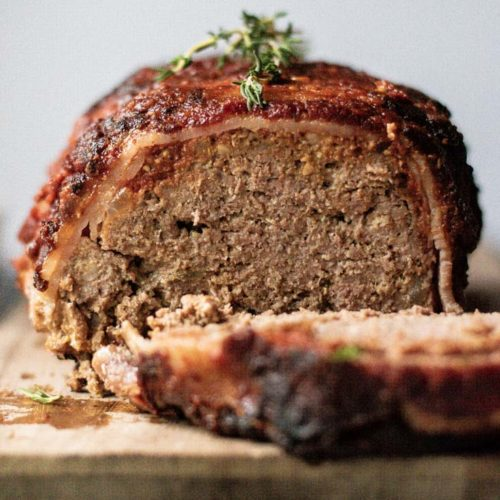 Front view of sliced bacon wrapped meatloaf