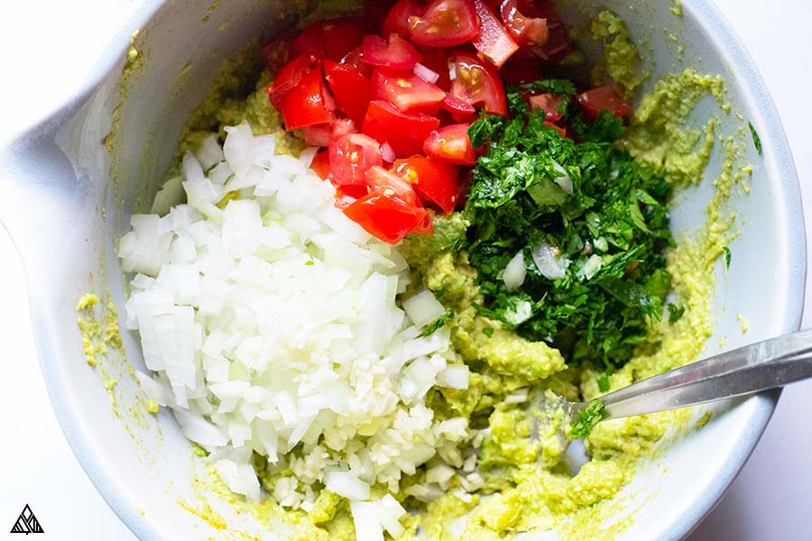 Mixing all the ingredients for guacamole