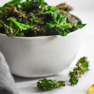 Kale chips in a white bowl