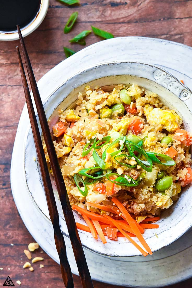 Top view of cauliflower fried rice with a pair of chopsticks