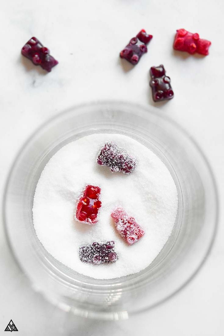 Keto gummy bears in a bowl of sugar