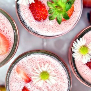 Top view of 2 glasses strawberry smoothie