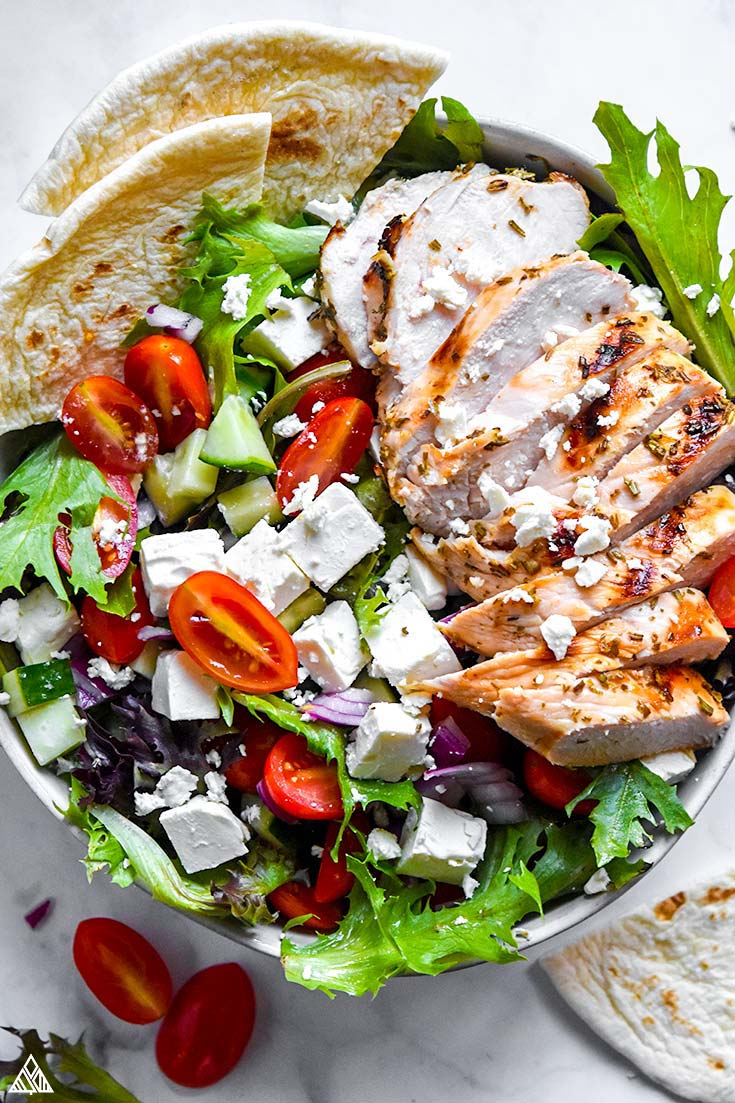 Top view of greek chicken salad in a bowl