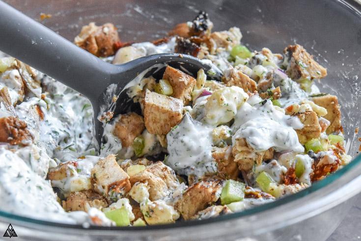 Mixing the ingredients for greek yogurt chicken salad