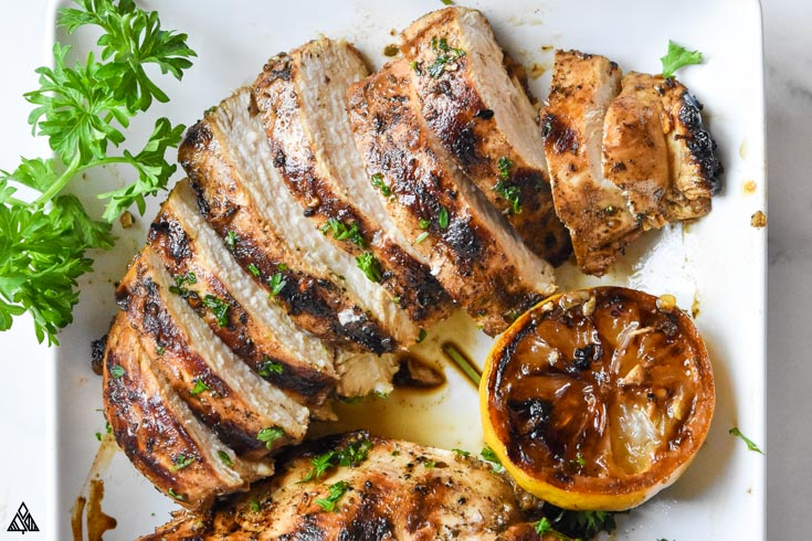 Closer look of a sliced mediterranean chicken marinade