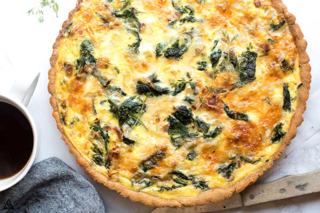 Top view of cooked spinach quiche