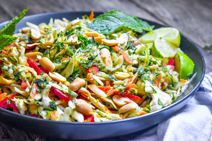 Side view of thai chicken salad in a bowl