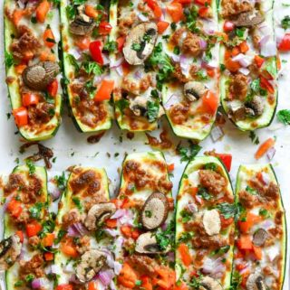 zucchini pizza boats on a pan
