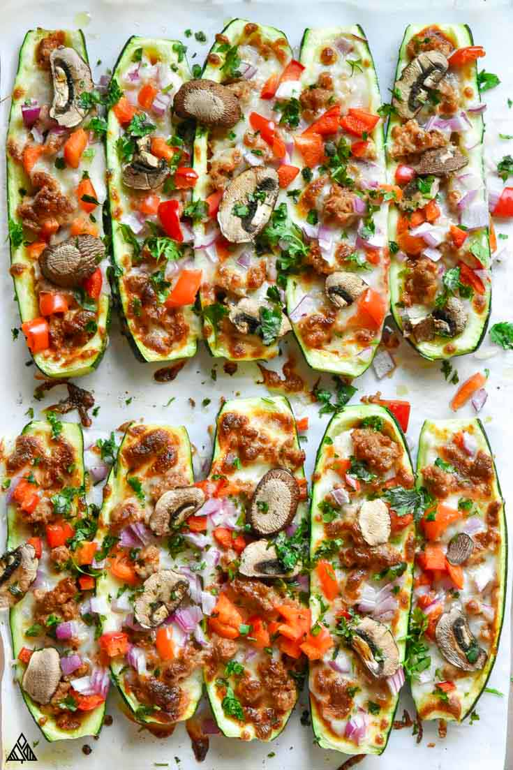 zucchini pizza boats on a pan