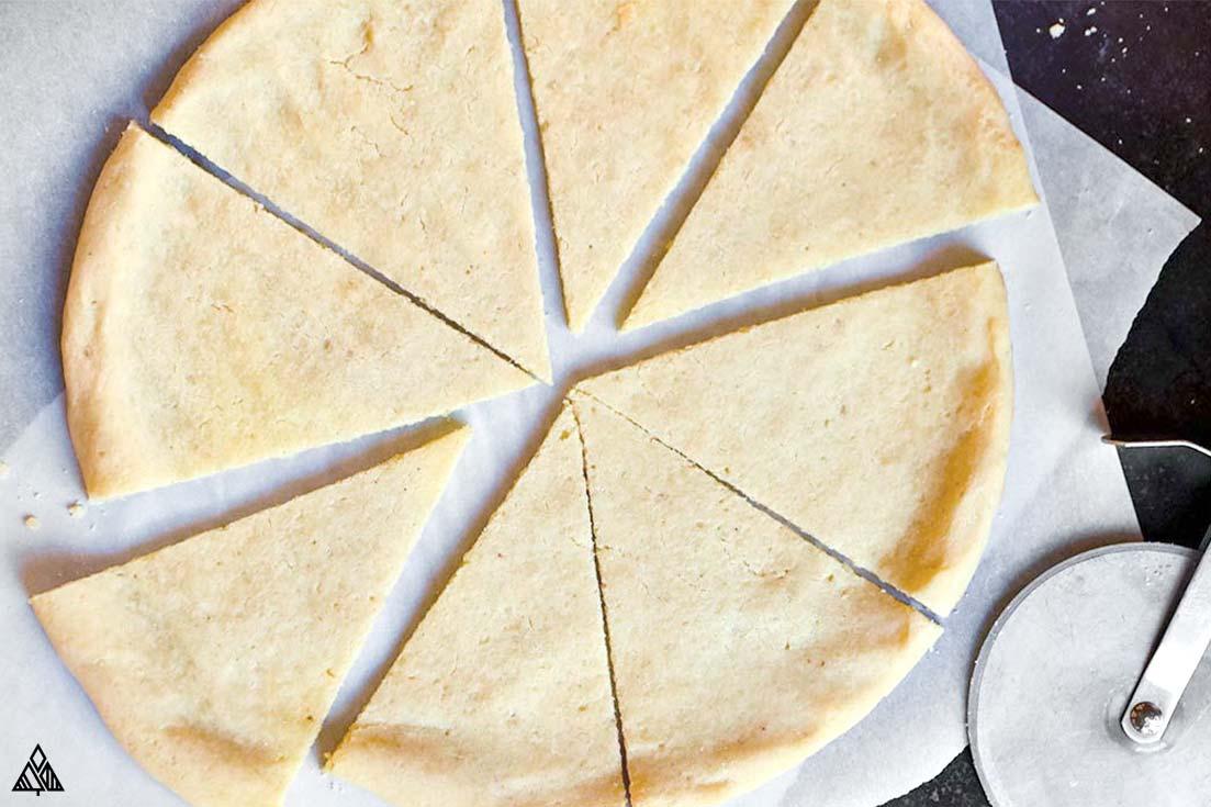 Sliced crust of almond flour pizza dough
