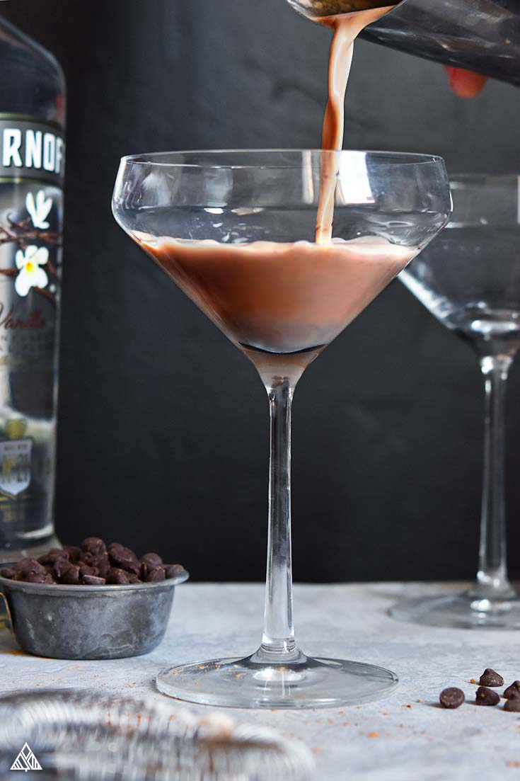 Pouring of low carb martini in a glass