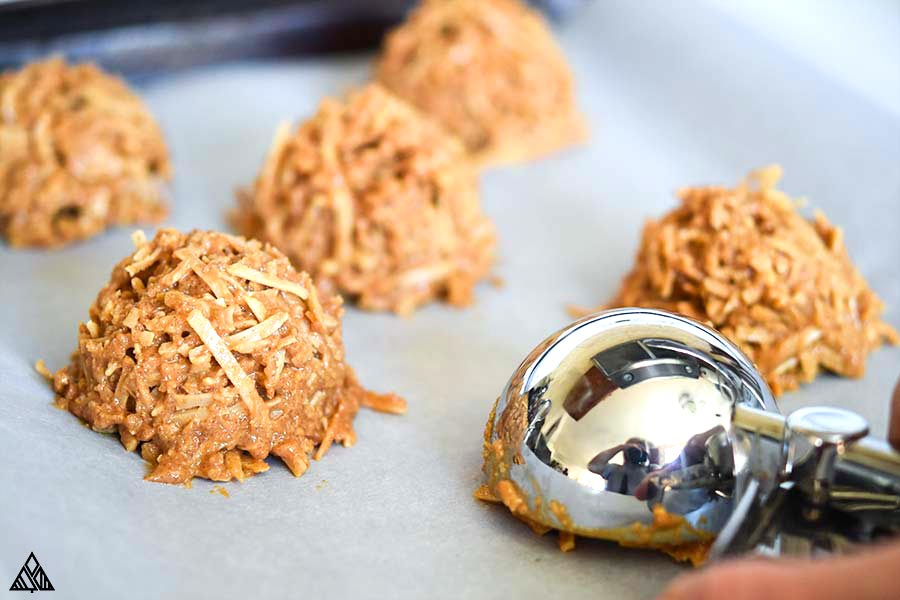 Scoops of healthy no bake cookies in a parchment paper