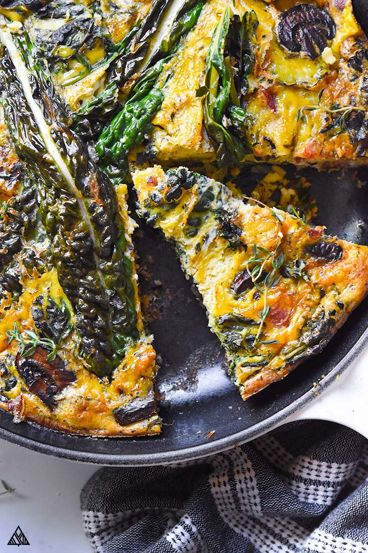 Top view of sliced mushroom quiche in a pan
