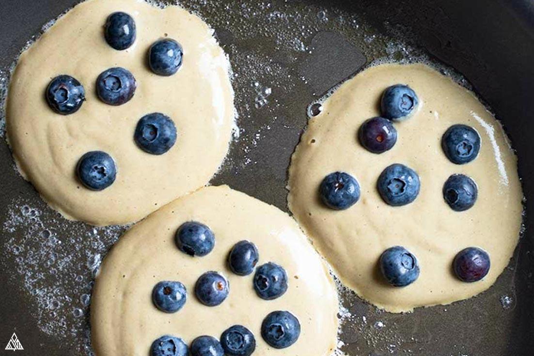 Cooking 3 pancakes in a pan