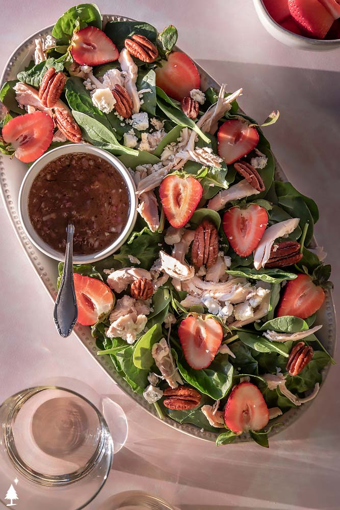 top view of spinach strawberry salad in a platter