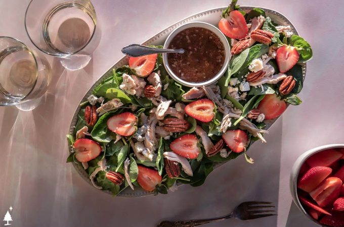 top view of strawberry spinach salad in a platter